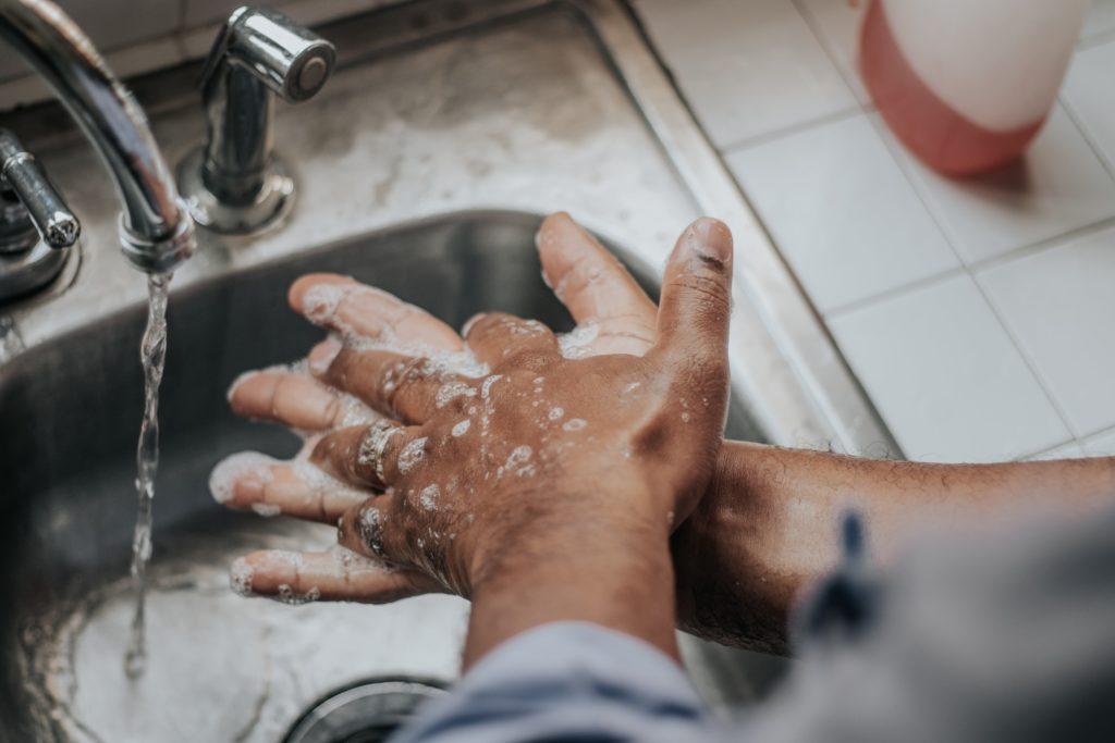 Man washing his hands